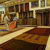 Carpets are presented with a flourish at the textile workshop.