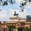 One of the statues of Altar of the Fatherland located at Piazza Venezia is seen here. The view is from ruins of Palatino.