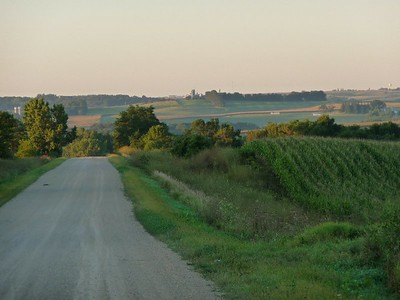 This road bisects the farm view looking south our land to the right and left of this road.