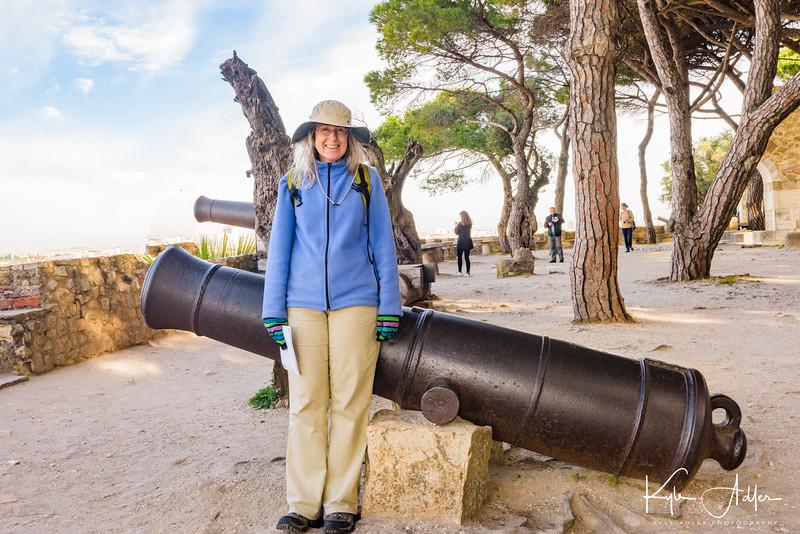 Mary strikes her traditional cannon pose at Lisbon's Castelo de São Jorge.