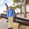 Mary strikes her traditional cannon pose at Lisbon's Castelo de São Jorge.