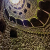 Descending the curved staircases of Quinta da Regaleira's tower.