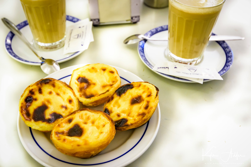 Enjoying the Lisbon obsession, the sublime custard pastry known as Pastel de Belém, at the cafe that invented them (well, the recipe was probably borrowed from the Jerónimos Monastery next door).