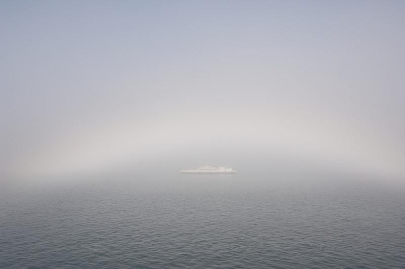Madeline Island ferry as the fog clears -- a fog bow.