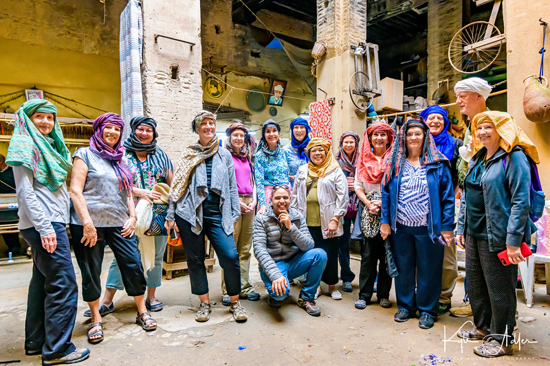 Our intrepid group poses wearing traditional Moroccan turbans at the caravansary.