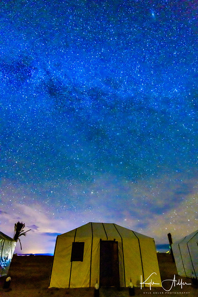 Spectacular night sky above our tented home in the middle of the Sahara Desert, featuring a brilliant Milky Way.