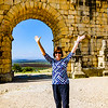 Fellow traveler Mary Kay is triumphant in front of the Triumphal Arch in Volubilis.