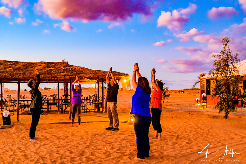 Fellow traveler Ruth leads an impromptu evening tai chi class at our tented camp.