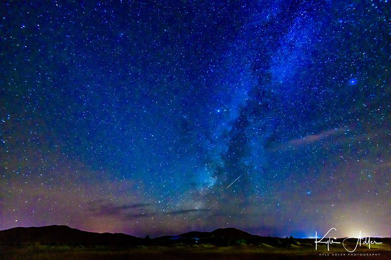 Spectacular night sky in the middle of the Sahara Desert featuring a brilliant Milky Way.
