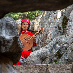 Local Sani woman in traditional costume, Stone Forest, Yunnan Province, China
