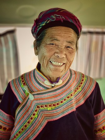 This lady is a member of the Miao ethnic group in Yunnan province, China. She was on the same bus travelling from the Vietnamese border to the city of Mengzi. She is 82 years old
