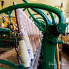 The Willamette Heritage Center is located in an old woolen mill.  Here is some old machinery at the ends of the loom, holding brightly colored bobbins of thread.