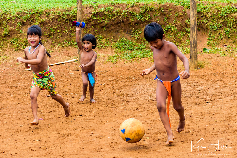 An impromptu soccer match in the green open area of the village.