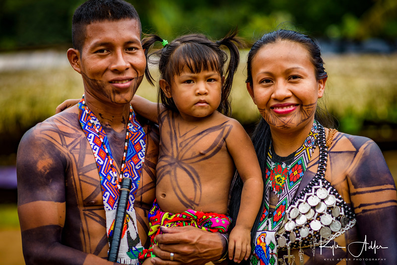 An Embera family pose for a portrait.