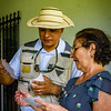 Trip leader Jorge consults with our home-hosted lunch host, Adita.