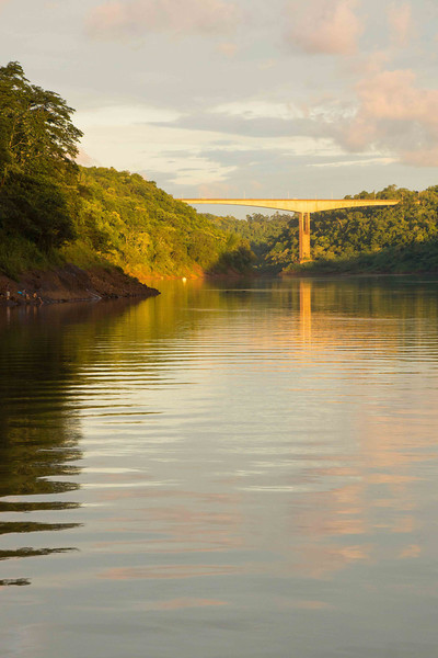 The sun is really low in the sky now; lighting the bridge on the Iguazu between Argentina and Brazil.