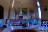 Peter and Jean Roy seen through a glass of pinot noir
