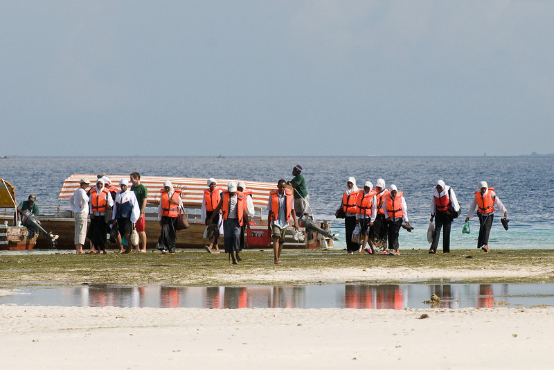 School children arrive from Zanzibar for a day of instruction and swimming lessons.