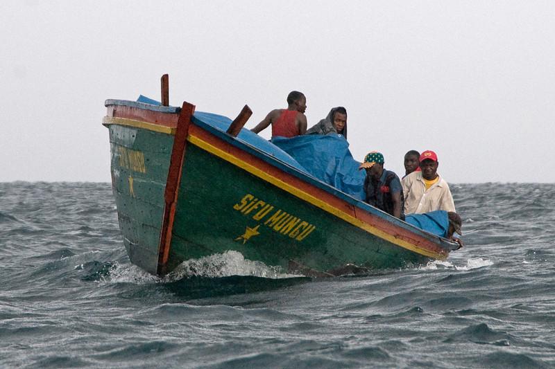 A public ferry boat in the rain.