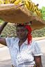 Woman taking bananas to market.