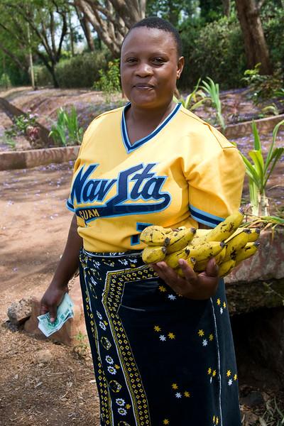 Woman selling bananas outside Moshi.