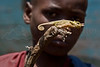 Chagga boy with chameleon.