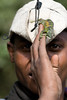 Our Maasai guide, Edward, with a chameleon.