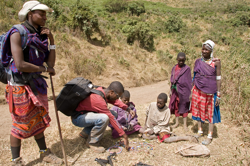 Our guides, Edward and Tunzo, buying jewelry along our trek.