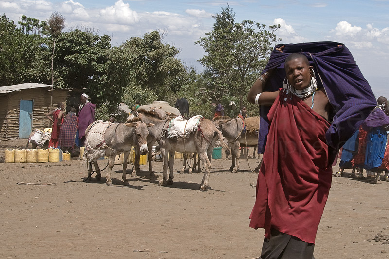 A Masai woman with her water in Nayobi.