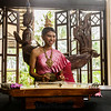Woman playing Thai traditional instrument