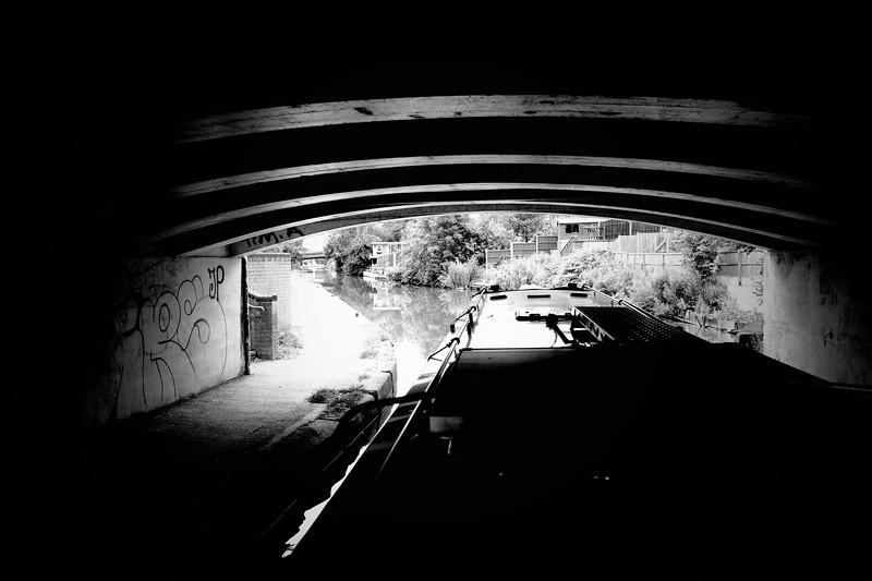 Boat Exiting Dark Tunnel