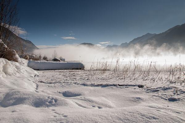 Winter fog over the frozen lake
