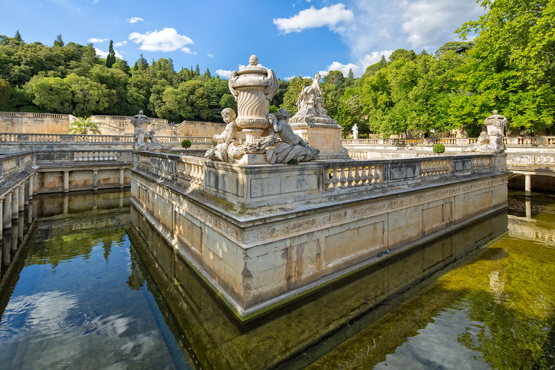 Detail of the beautiful fountain in the Jardin de la Fontaine in Nimes