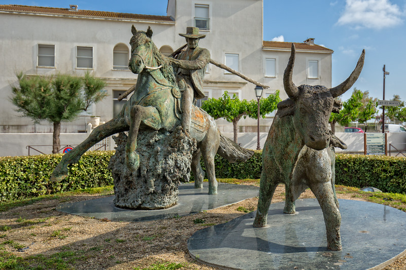 Sculpture of Guardian on Camargue horse and beside a Camargue bull