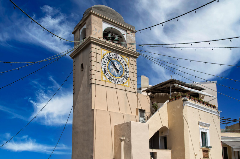 Clock tower of Church of Saint Santo Stefano in Capri town in Italy