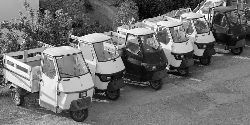 Piaggio Ape vehicles parked on a street