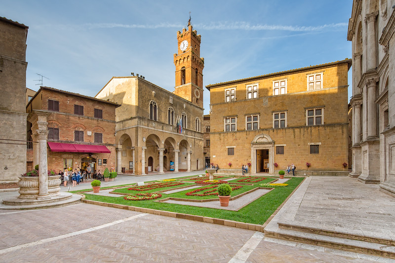 Tourists and local people on the Piazza in the old town of Pienza