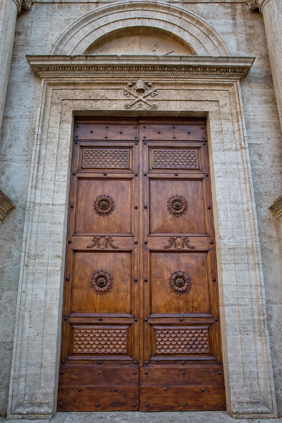 Detail of the door of Pienza cathedral