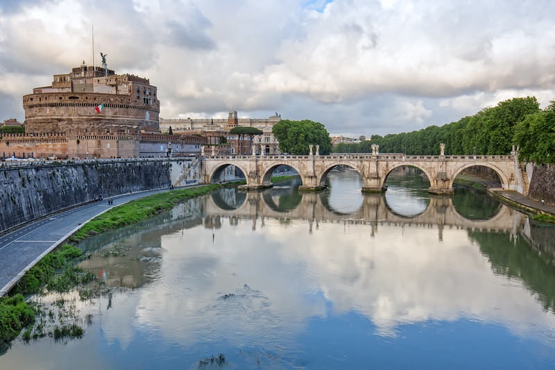 Castel Sant'Angelo and bridge with beautiful reflections on the Tiber river