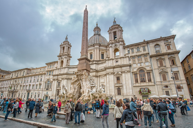 Tourists visit the famous Piazza Navona square in Rome