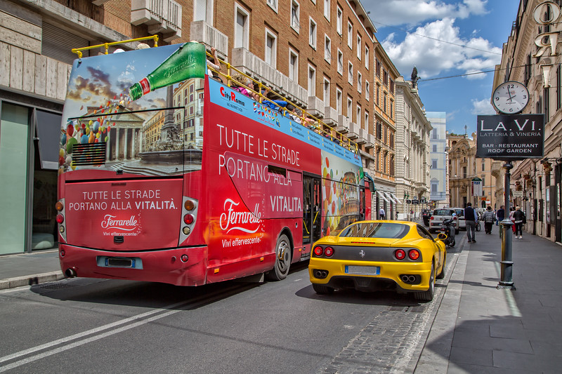 Sightseeing by city bus on a beautiful summer day in Rome