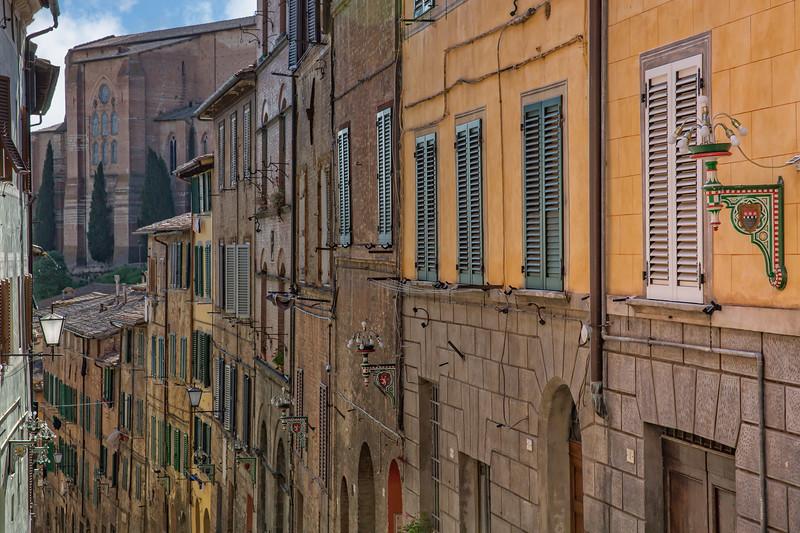 Medieval narrow cozy street in Siena
