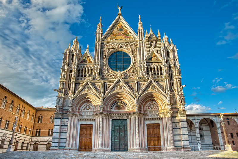 Duomo di Siena is a romanesque-gothic cathedral it is a major tourism attraction in Siena