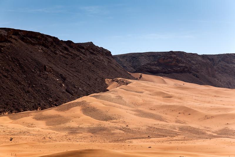 Where sand and mountain meet.