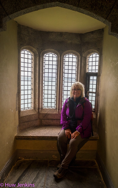 Mary sits in  window seat in the castle at St Micheals Mount , Cornwall