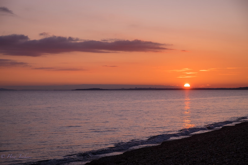 Sunset from Dels beach hut. Milford on Sea.