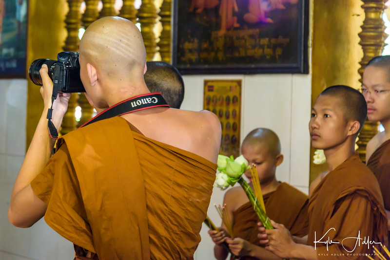 The truly enlightened Buddhist monk would, of course, be shooting Nikon.