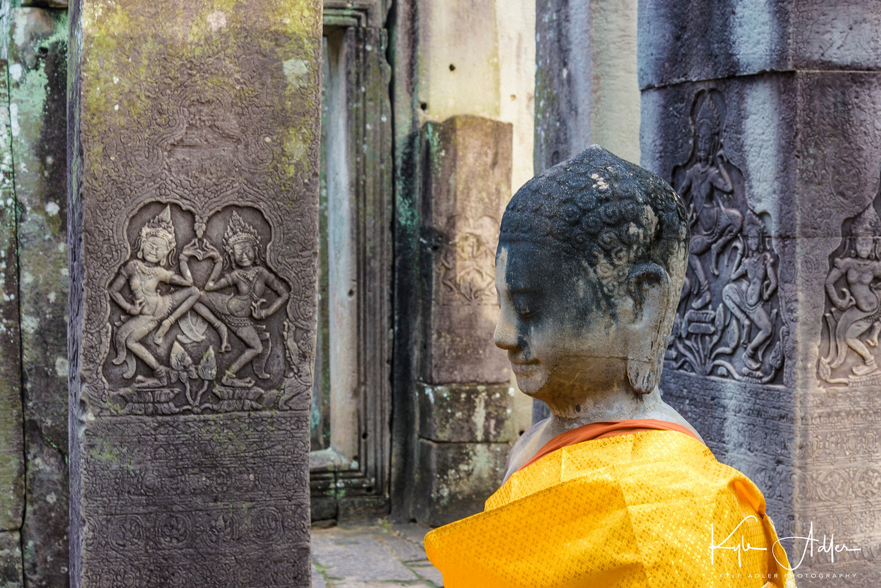 Buddha statue and carvings at Bayon Temple.