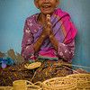 This village elder demonstrates traditional basket making.