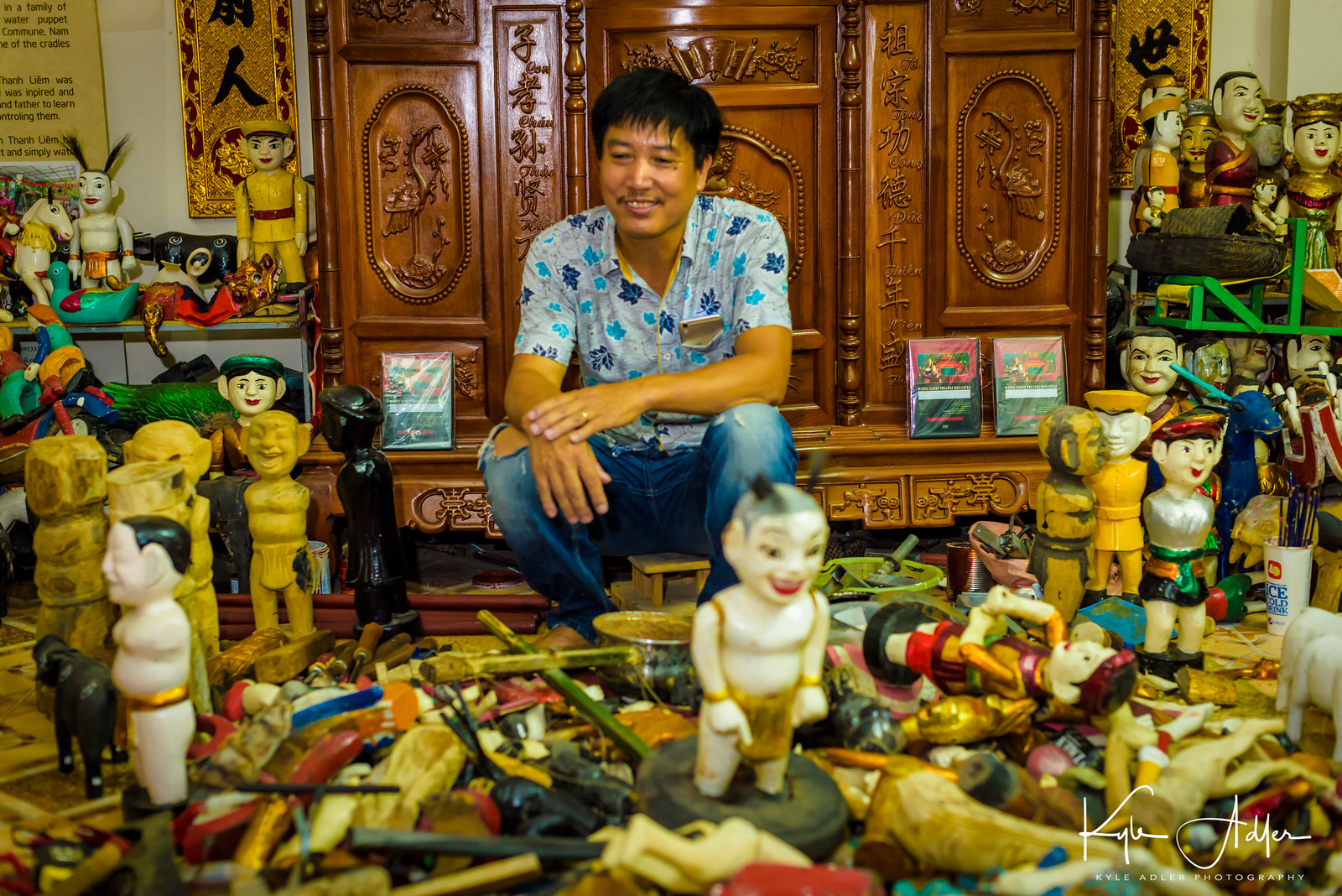 Mr. Phan in his workshop with just a few of the puppets he has crafted.  We purchased two puppets as souvenirs of our visit.